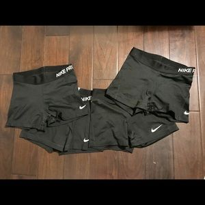 Nike Shorts - 4 PAIRS of Nike Pro Spandex. Size Medium.